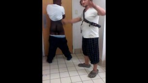 White Guy Spanks Black Guys Butt in the Bathroom with his Belt