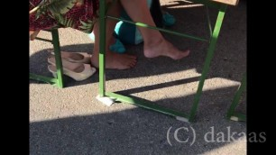 Mature Bare Feet under the Table