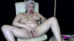 How beautiful is this juicy Mature bitch with a shaved pussy